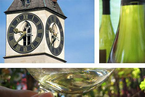 St. Peter's clock, Zurich, Switzerland, wine glasses, and wine bottle. Image by A. Haenni